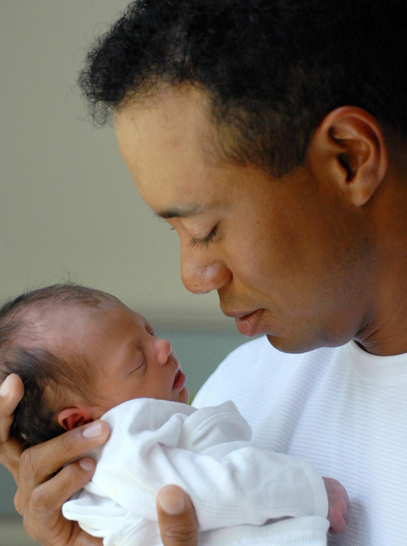 PAR I HJERTER: Den verdensberømte golfspilleren Tiger Woods ble far til datteren Sam Alexis Woods i fjor. Han er gift med en svensk modell, Elin Nordegren.  Foto: Stella Pictures