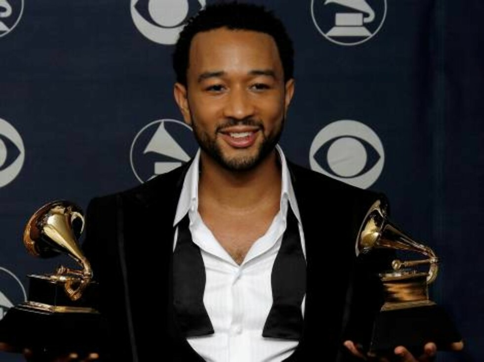 """LOS ANGELES, CA - FEBRUARY 11:  Musician John Legend poses with his Grammys for Best R&B Performance By a Duo or Group with Vocals for """"Family Affair"""" and Best Male R&B Vocal Performance for """"Heaven"""" in the press room at the 49th Annual Grammy Awards at t Foto: All Over Press"""