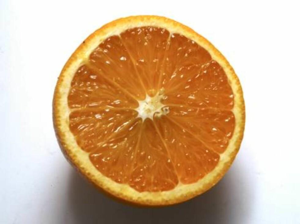 En oppskåret appelsin. Sitrusfrukt. C-vitaminer. Sunn. Sunnhet. Kosthold. Helse. Frukt. FOTO: SCANPIX Foto: SCANPIX