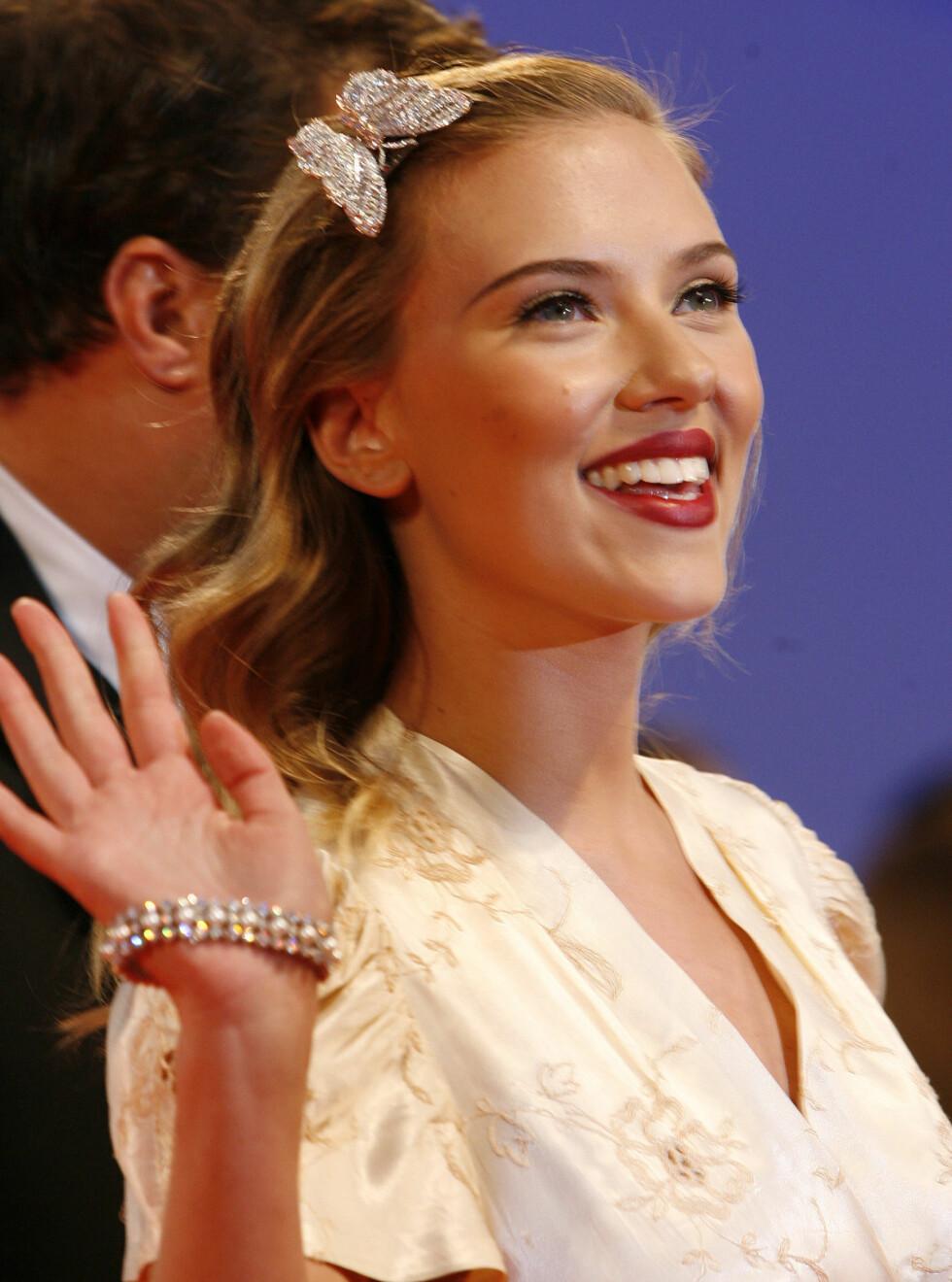 GLAD: Det virker ikke som Scarlett depper spesielt mye etter bruddet med Josh. Foto: AP