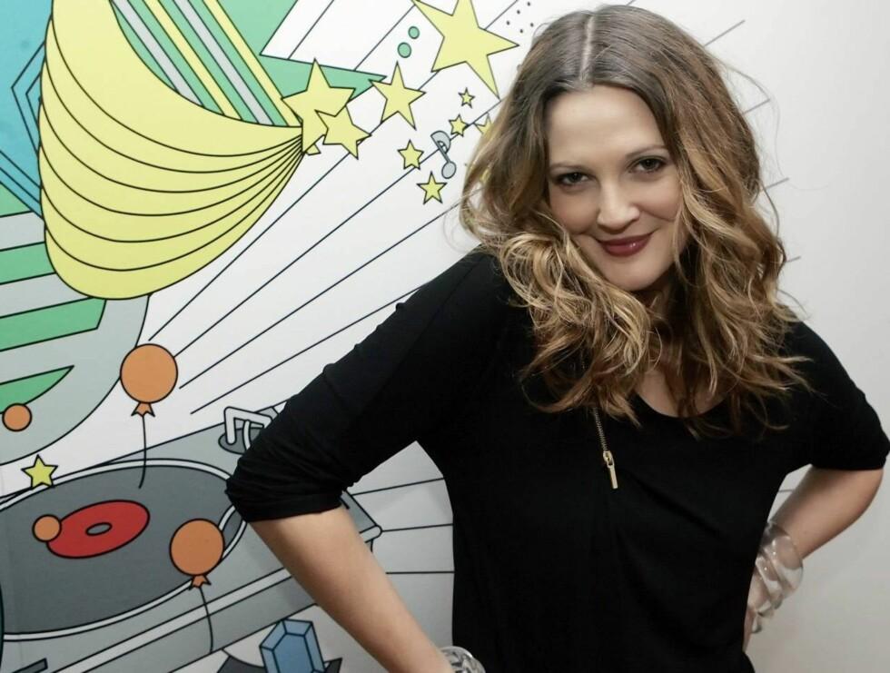 SØT: Hun ser svært yndig ut, men Drew Barrymore er kjent for å være en av de gærneste jentene i Hollywood.  Foto: AP/Scanpix