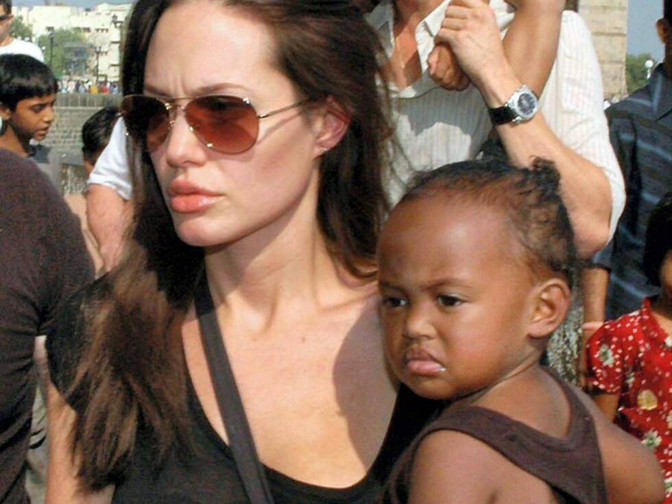 ADOPTIVBARNA: Angelina og Brad har adoptert to barn fra før, nå ønsker de seg i følge ryktene en liten gutt til. Foto: All Over Press