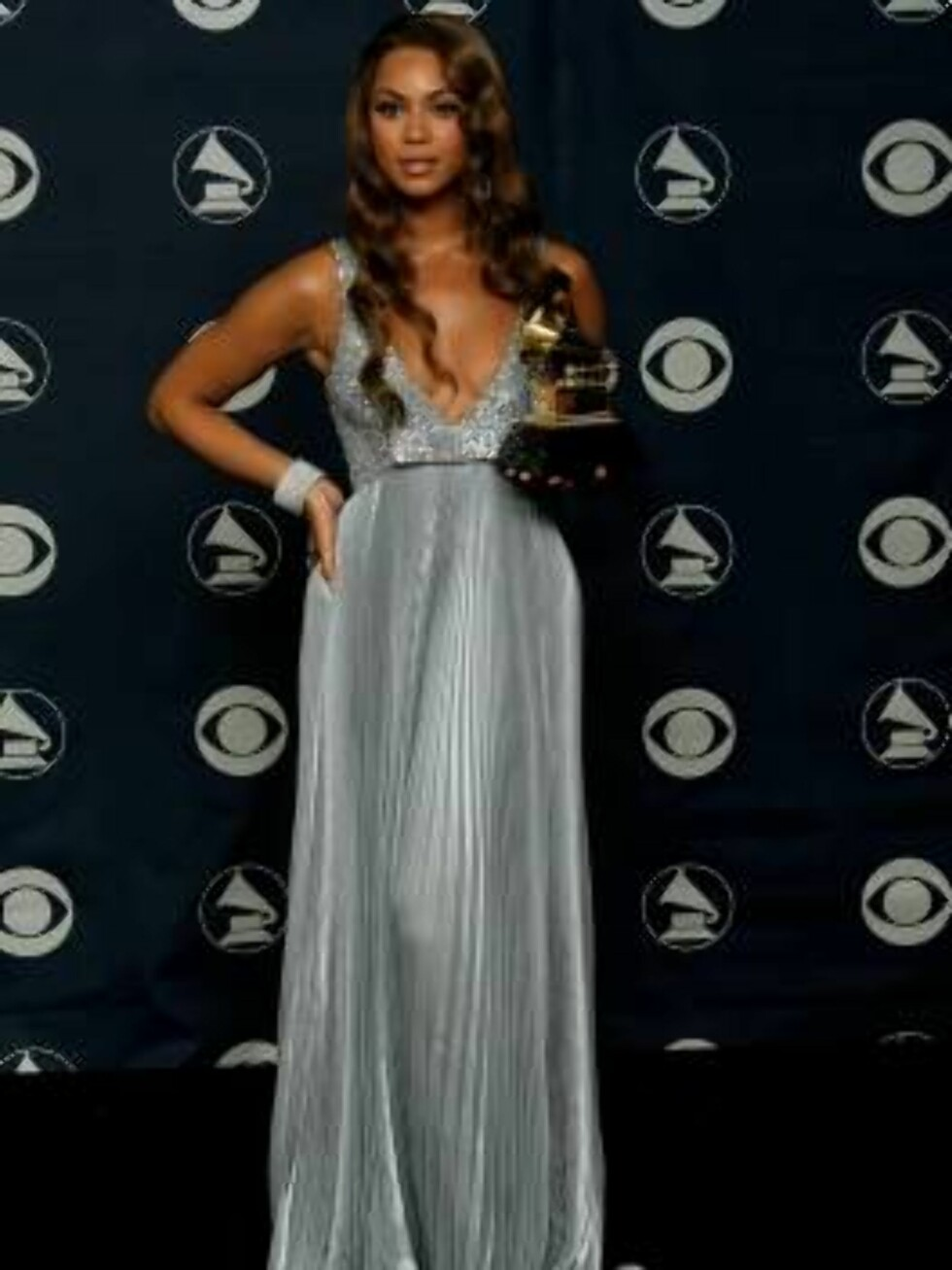 """LOS ANGELES, CA - FEBRUARY 11:  Singer Beyonce Knowles poses with her Grammy for Best Contemporary R&B Album for """"B'Day"""" in the press room at the 49th Annual Grammy Awards at the Staples Center on February 11, 2007 in Los Angeles, California.  (Photo by V Foto: All Over Press"""