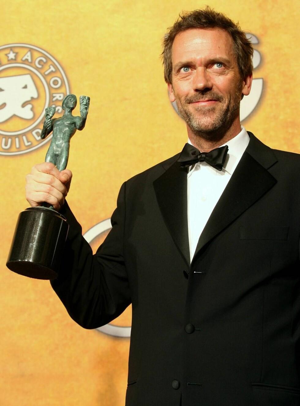 PRISBELØNT: Hugh Laurie har vunnet en rekke statuetter for sin rolle som den asosiale legen. Foto: All Over Press