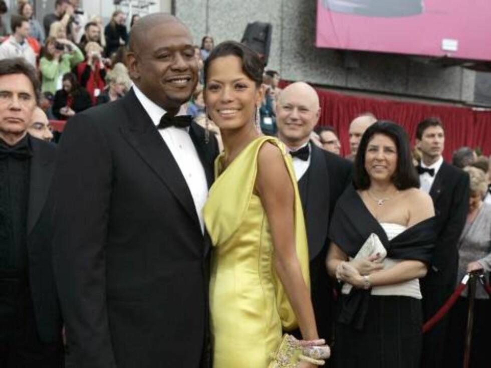 """OSCAR 2007: Skuespilleren Forest Whitaker og hans kone Keisha visste lite om at """"The Last King of Scotland""""-stjernen skulle vinne en gullstatue like etter. Foto: AP/Scanpix"""