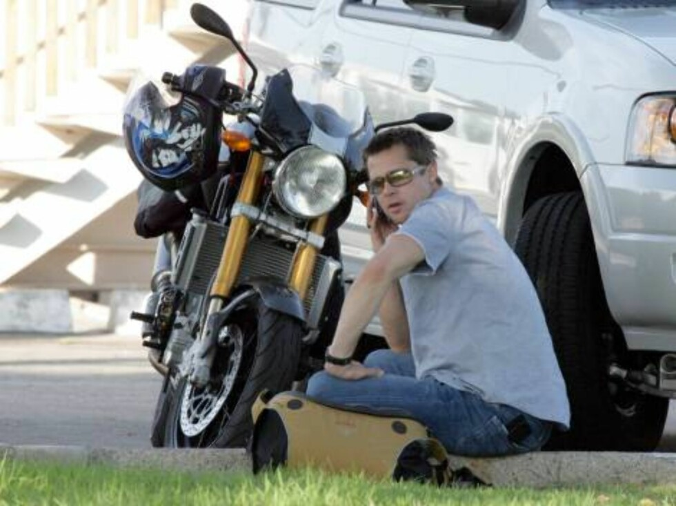 After months of stress Brad Pitt finally cools off in Santa Monica seating near his favorite motorcycle on the grass, talking on the phone. July 21, 2006 X17agency EXCLUSIVE Foto: All Over Press