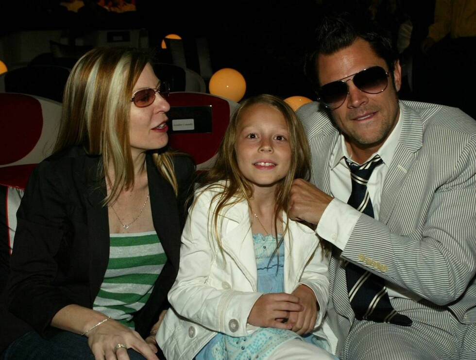 SAMMEN: Johnny og Melanie var gift i hele 12 år, noe som er en evighet i Hollywood. Sammen har de datteren Madison på 10 år. Foto: All Over Press
