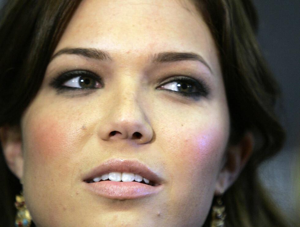 DEPPA: Det hjalp ikke på Mandys humør at det ble slutt med kjæresten Zach Braff i juni.  Foto: AP