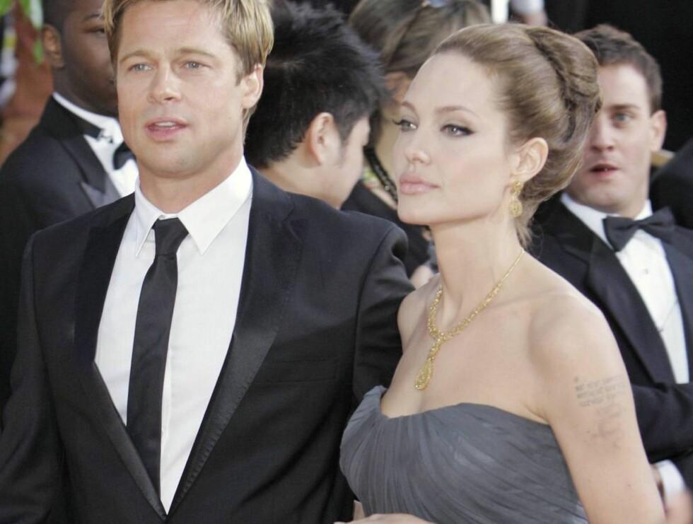 STRÅLTE: Både Brad og Angelina strålte under nattens Golden Globe Awards. Foto: AP