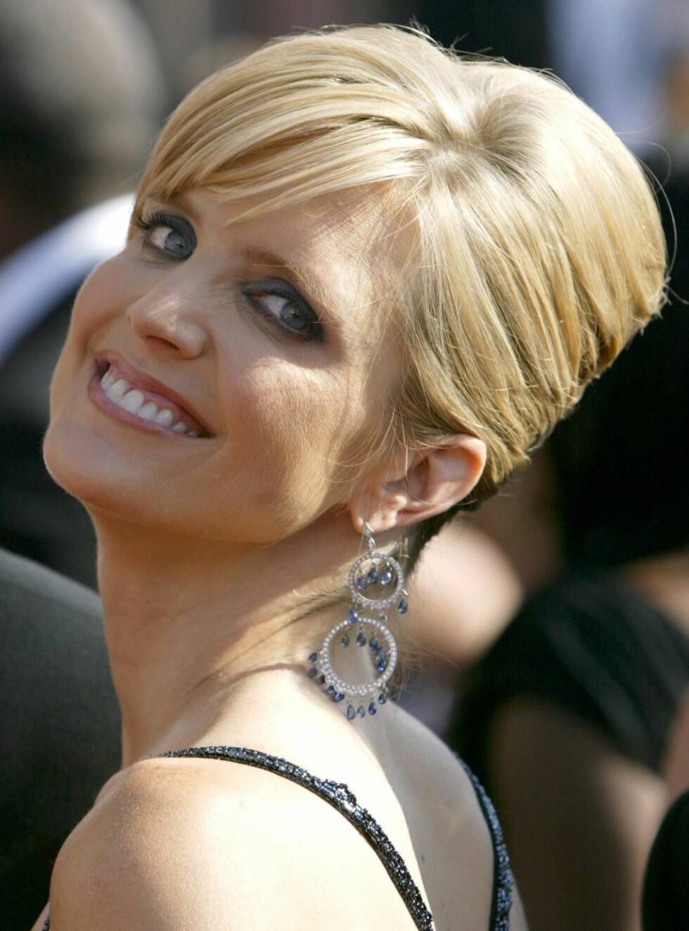 GIFT: Courtney Thorne-Smith giftet seg med sin kjære Roger Fishman 1. januar. Foto: All Over Press