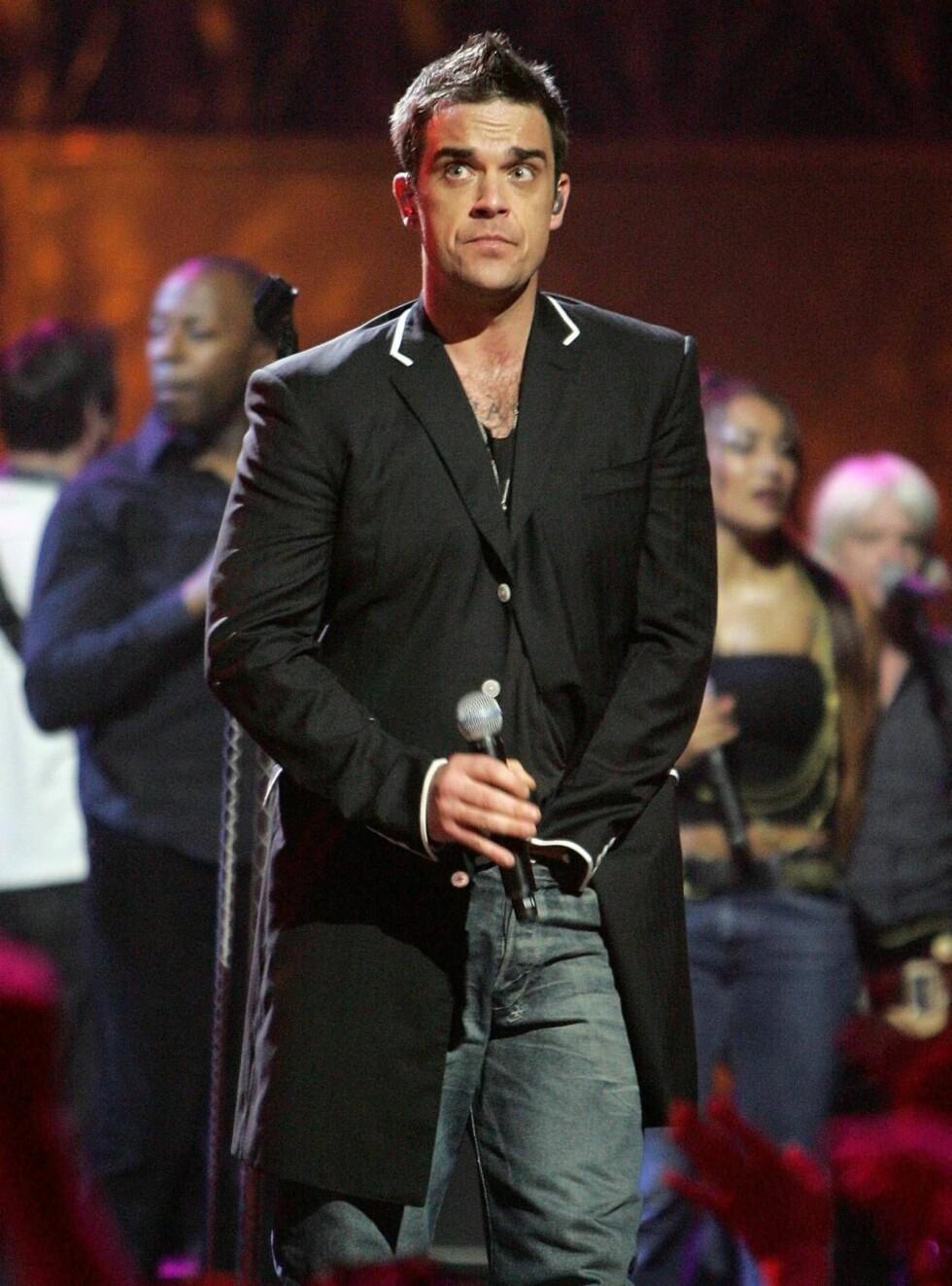 BABYNEKT: Robbie Williams har verken planer om karriere eller familie i fremtiden. Foto: All Over Press