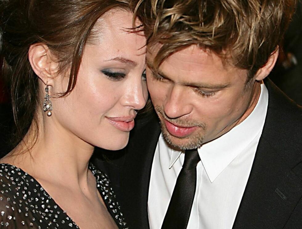 FORELSKET: Angelina og Brad er blitt foreldre til tre og er mer forelsket enn noensinne. Foto: All Over Press