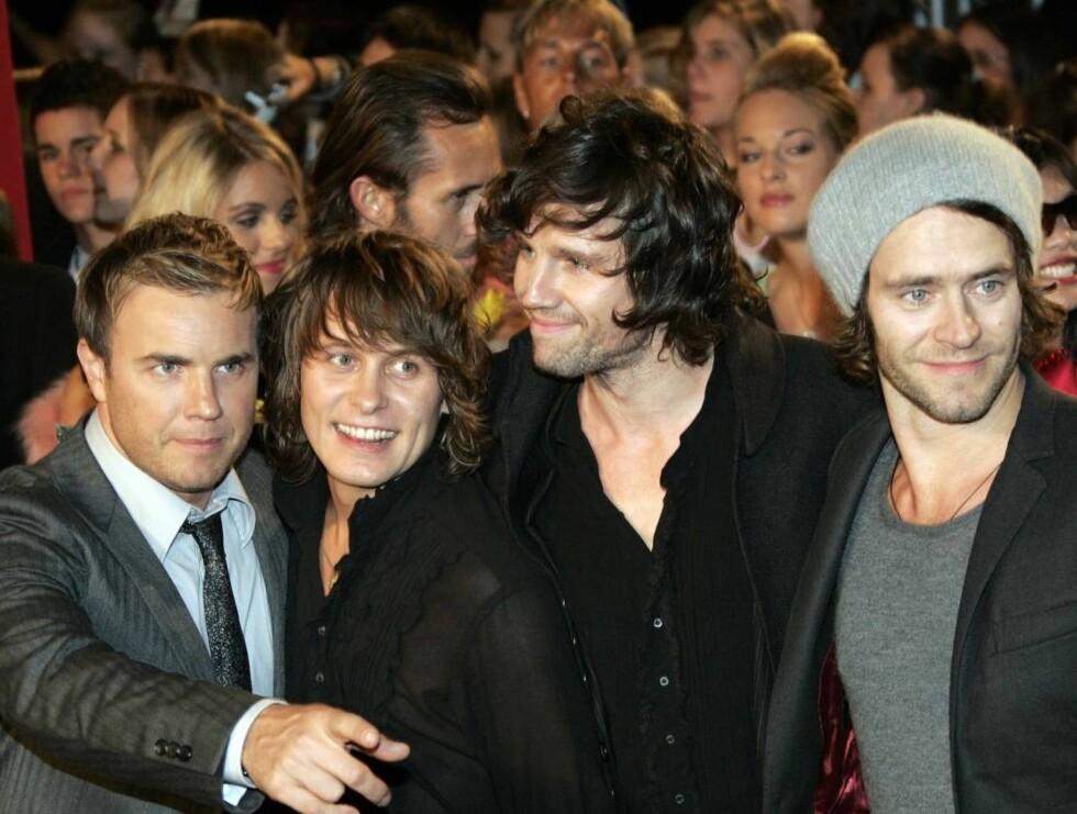 COMEBACK: Gary Barlow, Mark Owen, Jason Orange og Howard Donald jubler over sin nye suksess. Foto: AP