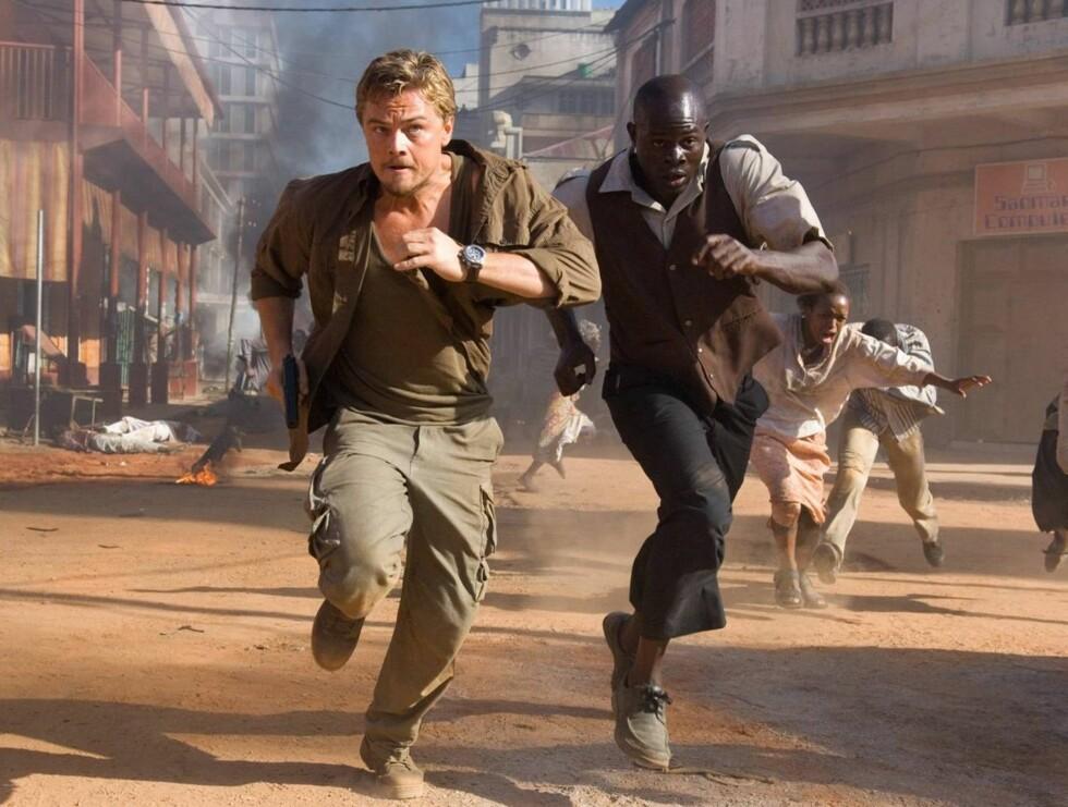 """FRYKT: Leonardo er litt av en tøffing. Bildet er fra innspillingen av """"Blood Diamond"""". Foto: AP/Scanpix"""