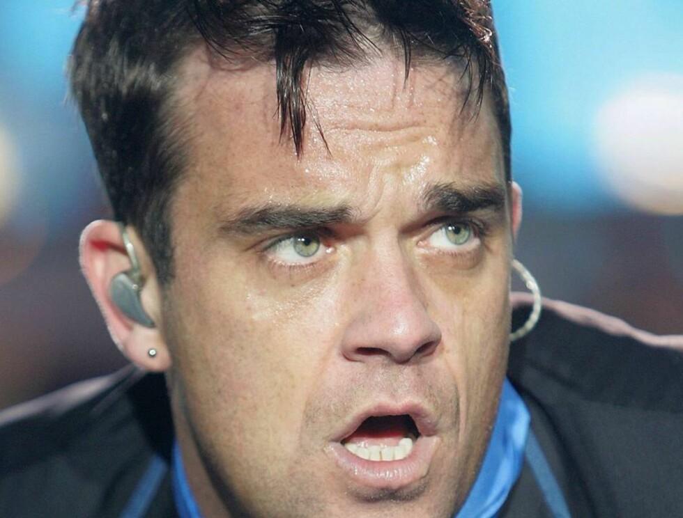 TJA TIL MENN: Robbie utelukker ikke at han kunne hatt sex med en mann. Foto: All Over Press
