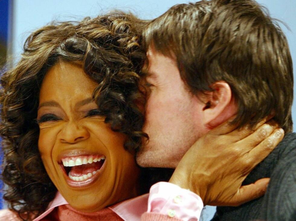 KYSS: Oprah og Tom er nære venner. Da han besøkte studioet hennes forrige gang, ble det kaos. Foto: AP/SCANPIX