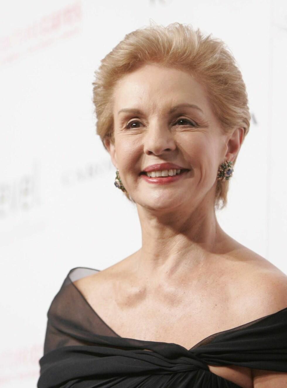 STOLT: Jaqueline Kennedys favoritt-designer smilte stort under gårsdagens kalas. Foto: AP/Scanpix