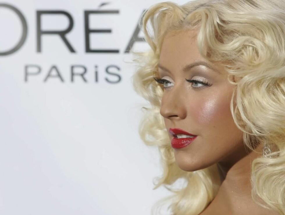 SEXY: Christina stiller i både nonnedrakt og med pisk når hun drar ut i den store verden. Foto: AP/Scanpix