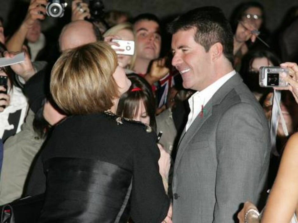 London 2006-11-06  Simon Cowell  and Sharon Osbourne  at the Pride of Britain Awards 2006 arrivals held at the LWT Studios in London.   Photo: Axel  Code:3008  COPYRIGHT STELLA PICTURES Foto: Stella pictures