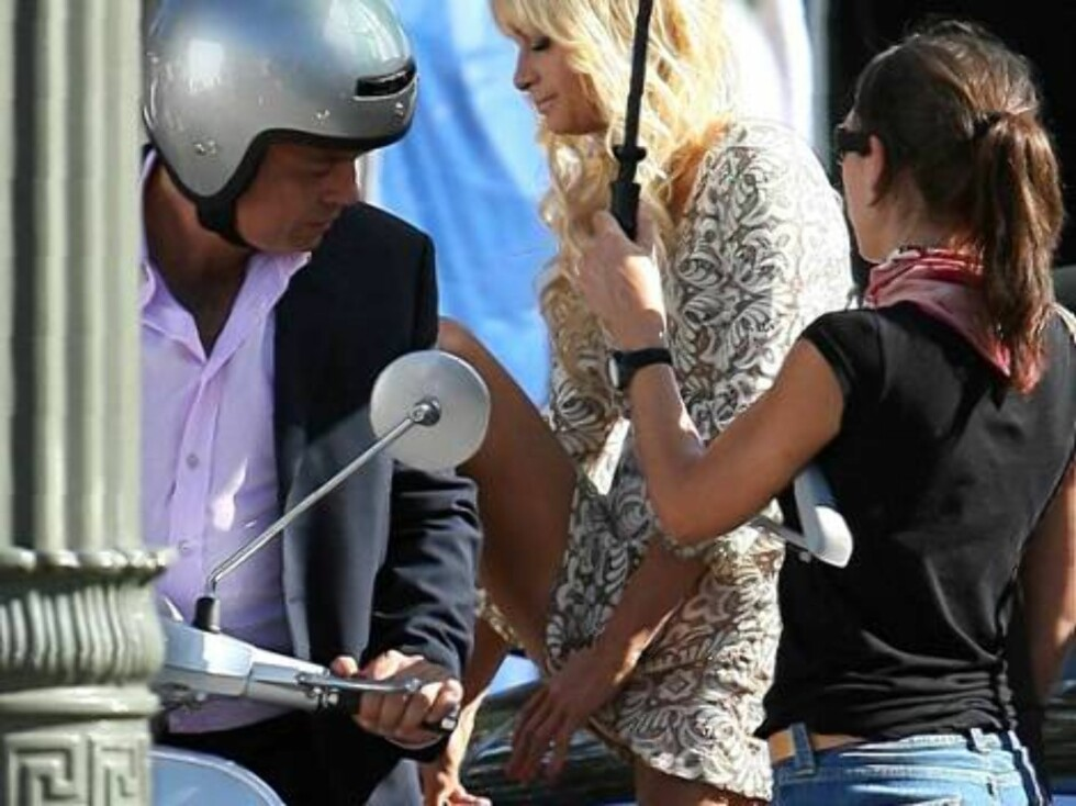 Paris Hilton makes money with an italian commercial and shows some skin as she climbs a scooter Vespa in Los Angeles. Nov6, 2006 X17agency exclusive Foto: All Over Press
