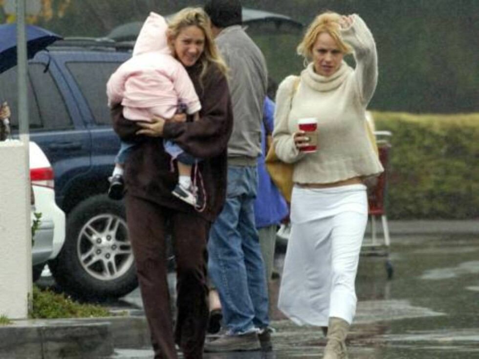 Even the mega-rich Pamela Anderson shops at the bulk discounter Costco.  Pammy braved the rain, coffee in hand, wearing boots and a skirt with messy hair.  She's suffering from an eye injury or pink eye.  December 14, 2003.  Exclusive X17agency.com  / AL Foto: All Over Press