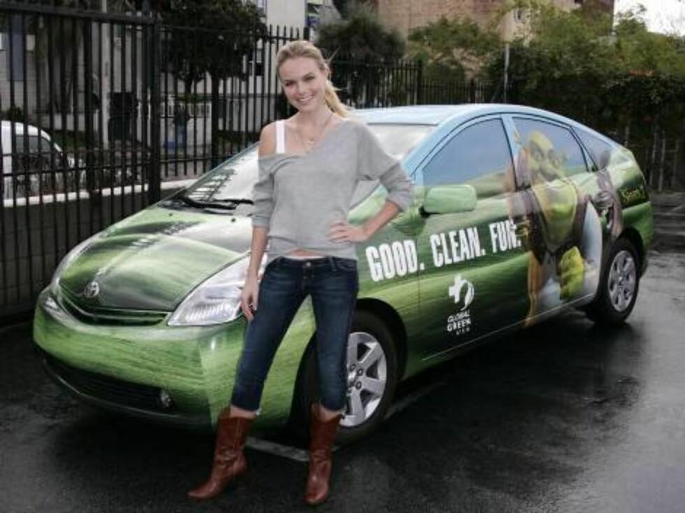Snertne Kate Bosworth reklamerer til og med for Toyotas hybrid-bil! Foto: All Over Press