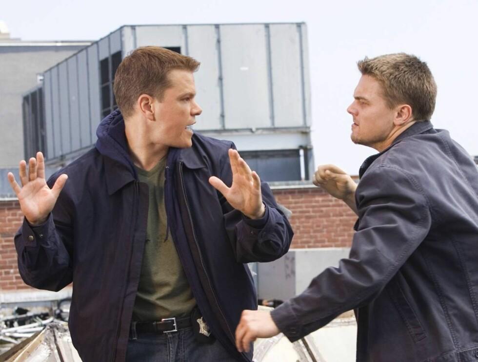 """SLOSS: I """"The Departed"""" går det hardt for seg. Her er Matt i kamp med selveste Leonardo DiCaprio. Foto: Filmweb"""