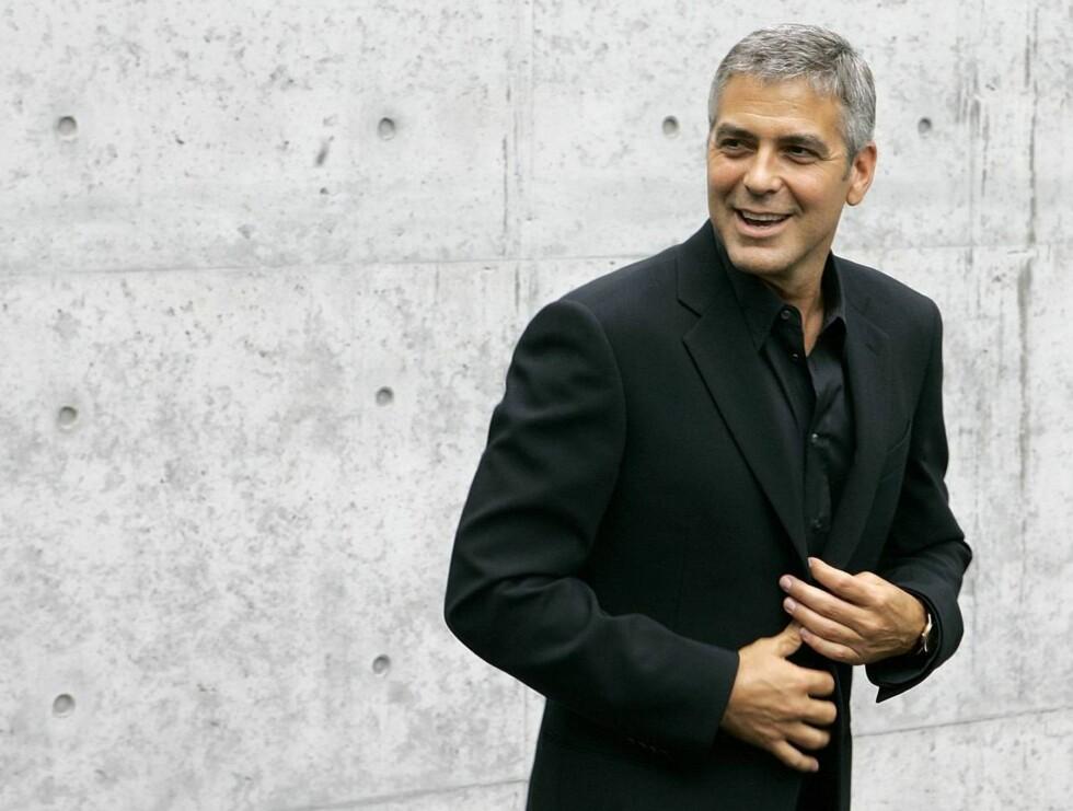 PINLIG: George Clooney trodde han hadde kommet til himmelen. Men så var det bare Hollywood. Foto: AP/Scanpix