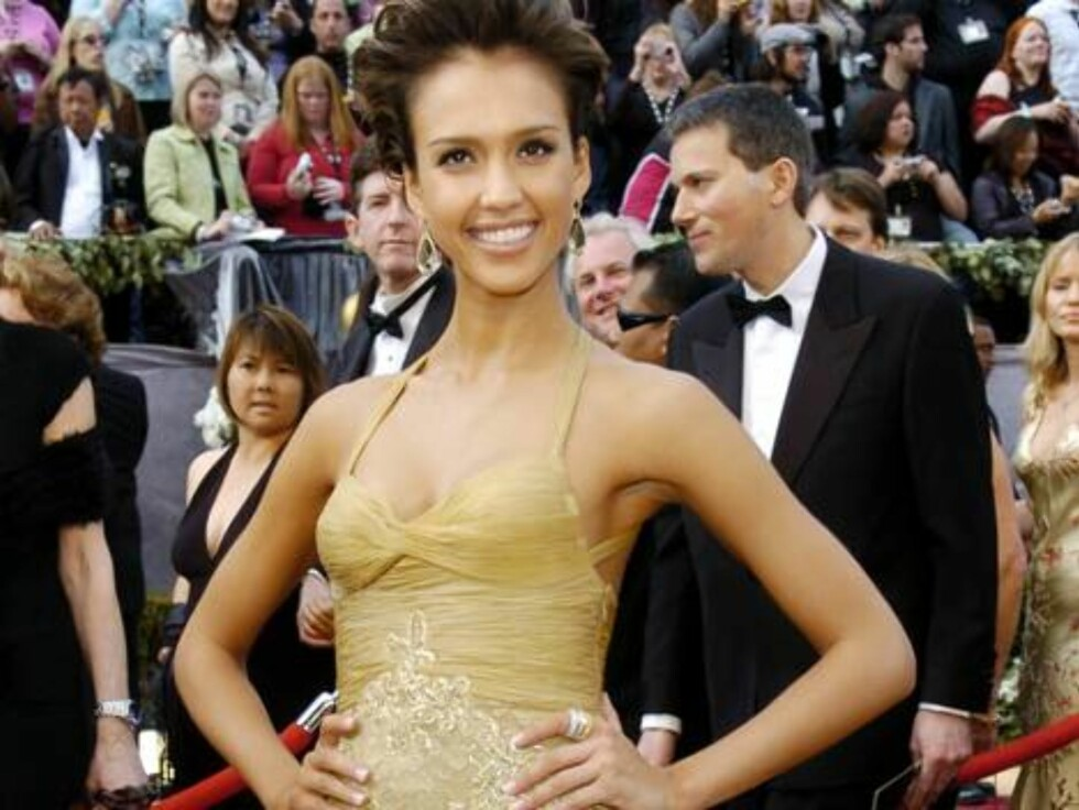 ** FILE ** Actress Jessica Alba arrives for the 78th Academy Awards in this March 5, 2006 file photo in Los Angeles. Alba's dispute with Playboy is over. The 24-year-actress has dropped demands the magazine pull its March issue after receiving a letter of Foto: AP/Scanpix