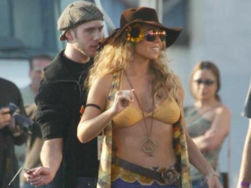 Mariah Carey gir freden en sjanse ved hjelp av et smykke. Foto: All Over Press