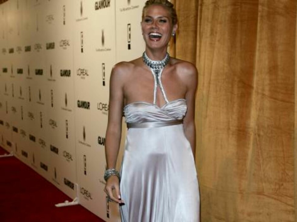 German model Heidi Klum arrives for the Weinstein Co. after-party following the 63rd Annual Golden Globe Awards on Monday, Jan. 16, 2006, in Beverly Hills, Calif. (AP Photo/Branimir Kvartuc) Foto: AP/Scanpix