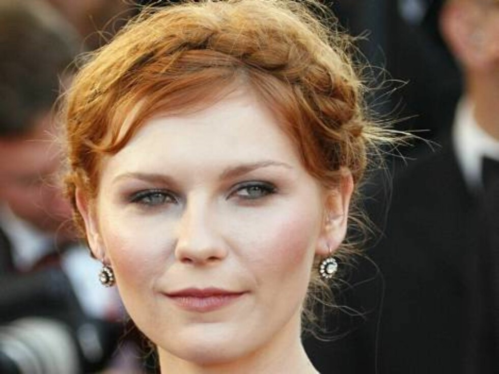 """American actress Kirsten Dunst arrives for the screening of the film """"Marie-Antoinette,"""" at the 59th International film festival in Cannes, southern France, on Wednesday, May 24, 2006.  (AP Photo/Laurent Emmanuel) Foto: AP/Scanpix"""