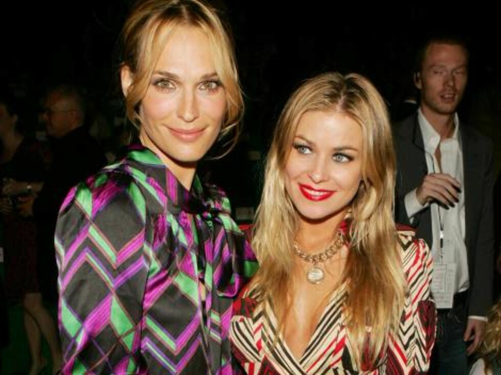 NEW YORK - SEPTEMBER 10:  Actresses Molly Sims and Carmen Electra pose in the front row at the Diane Von Furstenberg Spring 2007 fashion show during Olympus Fashion Week at the Tent in Bryant Park September 10, 2006 in New York City.  (Photo by Peter Kram Foto: All Over Press