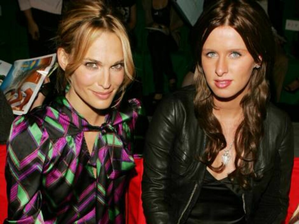 NEW YORK - SEPTEMBER 10:  Actress Molly Sims and Nicky Hilton pose in the front row at the Diane Von Furstenberg Spring 2007 fashion show during Olympus Fashion Week at the Tent in Bryant Park September 10, 2006 in New York City.  (Photo by Peter Kramer/G Foto: All Over Press