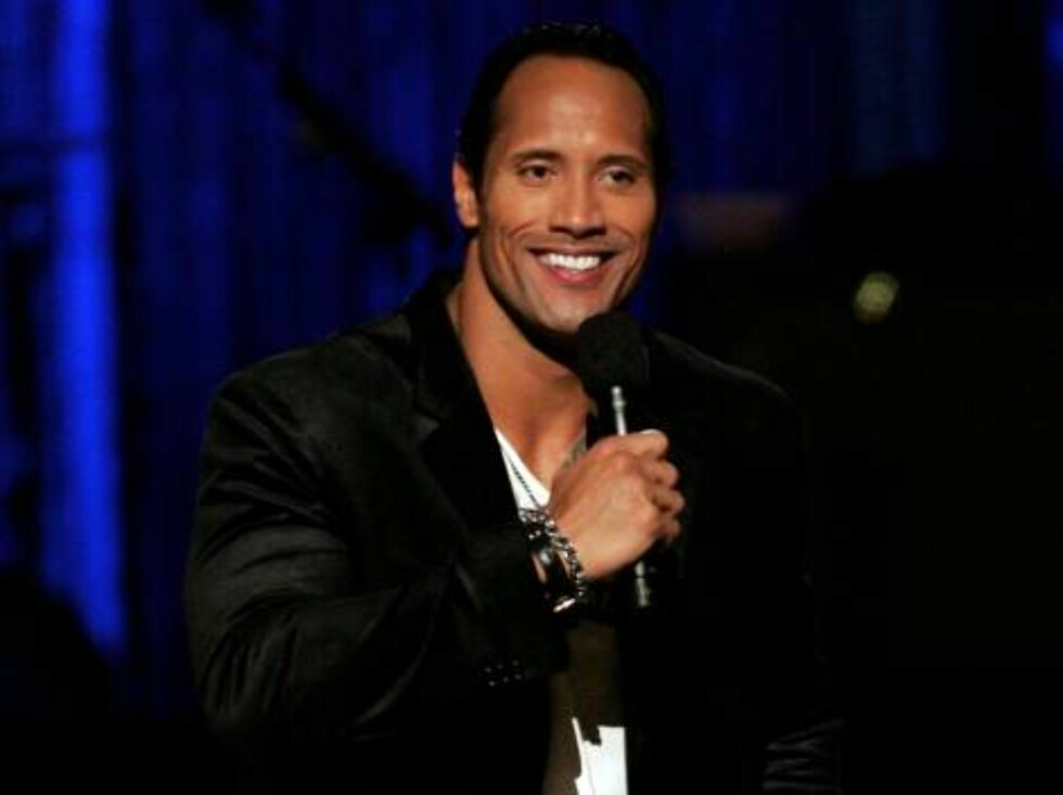 """NEW YORK - AUGUST 31:  Actor Dwayne """"The Rock"""" Johnson speaks onstage at the 2006 MTV Video Music Awards at Radio City Music Hall August 31, 2006 in New York City.  (Photo by Scott Gries/Getty Images) *** Local Caption *** Dwayne """"The Rock"""" Johnson  * SPE Foto: All Over Press"""
