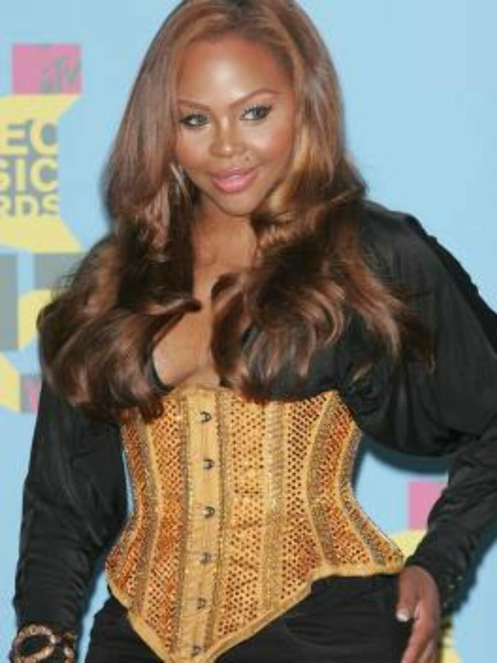 NEW YORK - AUGUST 31:  Rapper Lil Kim poses in the press room during the 2006 MTV Video Music Awards at Radio City Music Hall August 31, 2006 in New York City.  (Photo by Peter Kramer/Getty Images) *** Local Caption *** Lil Kim  * SPECIAL INSTRUCTIONS:  * Foto: All Over Press