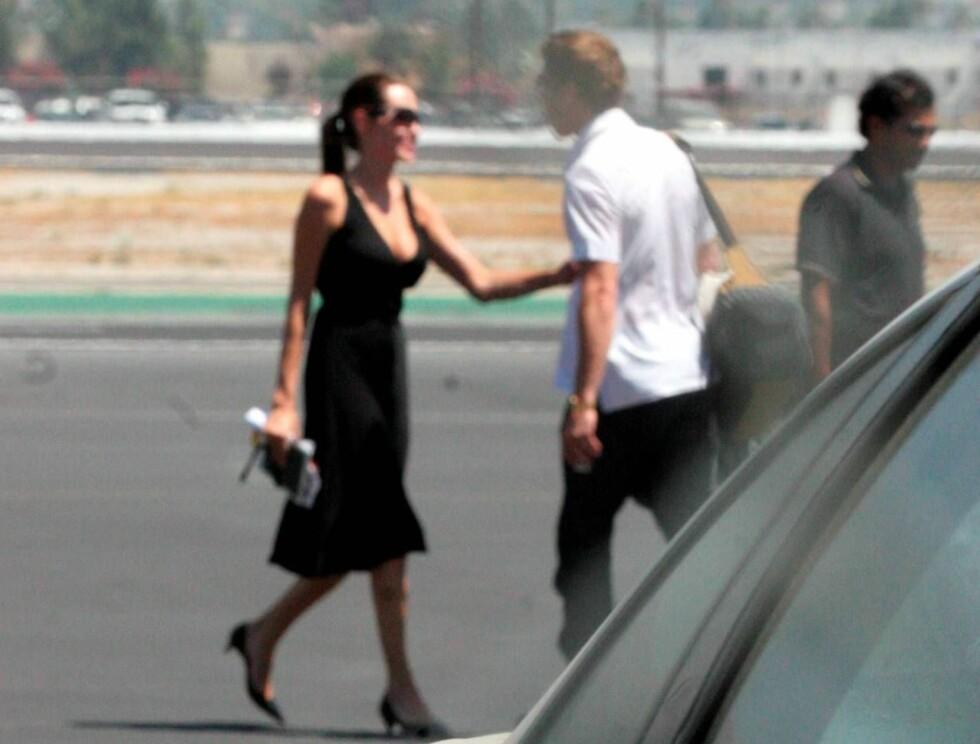 SMIL: Det var to svært forelskede stjerner som skulle ut på tur i helgen ... Foto: All Over Press