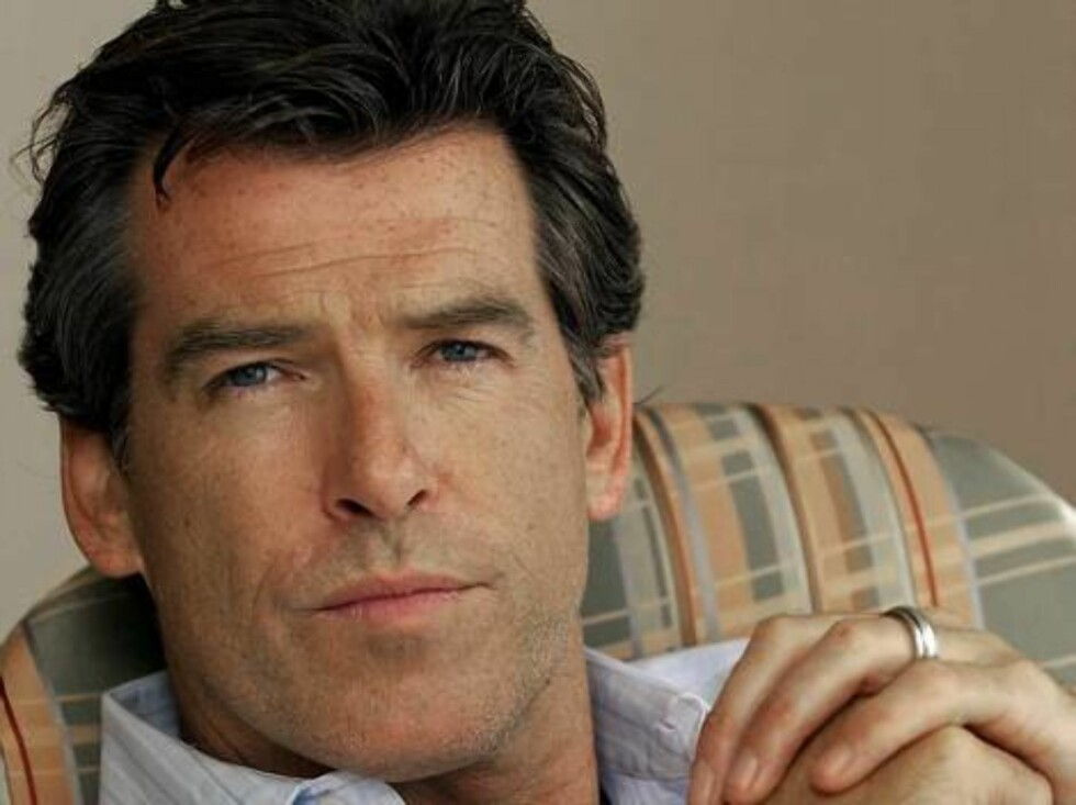 **FILE** Actor Pierce Brosnan poses for a photo during the Toronto International Film Festival in Toronto, in this Sept. 9, 2002, file photo. Brosnan has won control of the Internet name www.piercebrosnan.com in a ruling by a United Nations panel. (AP Pho Foto: AP/Scanpix