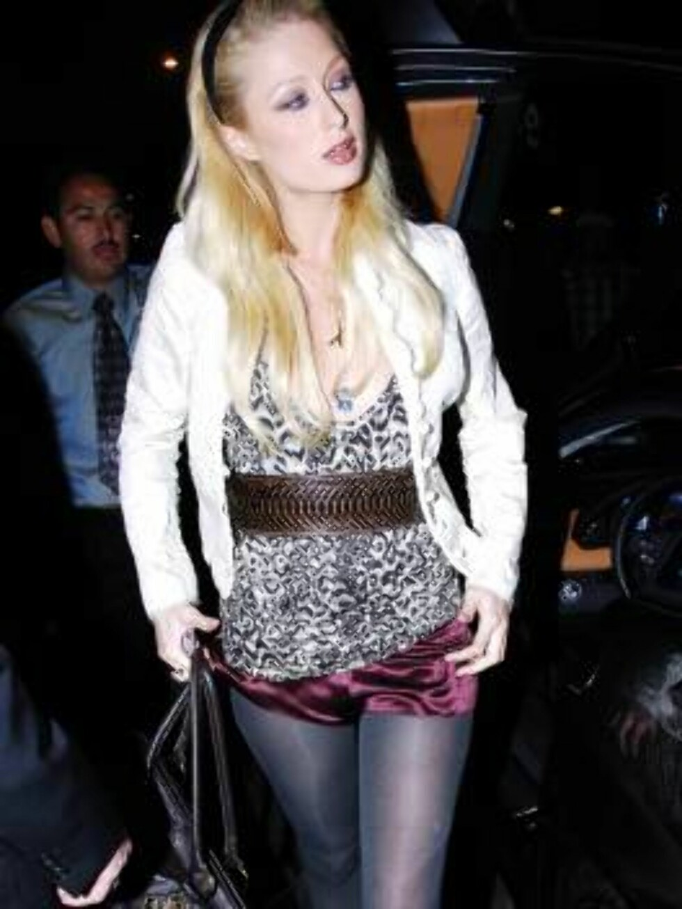 Paris Hilton leaving club Shag July 10, 2006 shows a strange style...X17agency exclusive Foto: All Over Press
