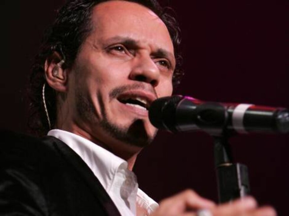 NEW YORK - AUGUST 09:  Musician Marc Anthony performs live on stage during the Juntos Tour concert at Madison Square Garden on August 9, 2006 in New York City.  (Photo by Bryan Bedder/Getty Images) *** Local Caption *** Marc Anthony  * SPECIAL INSTRUCTION Foto: All Over Press