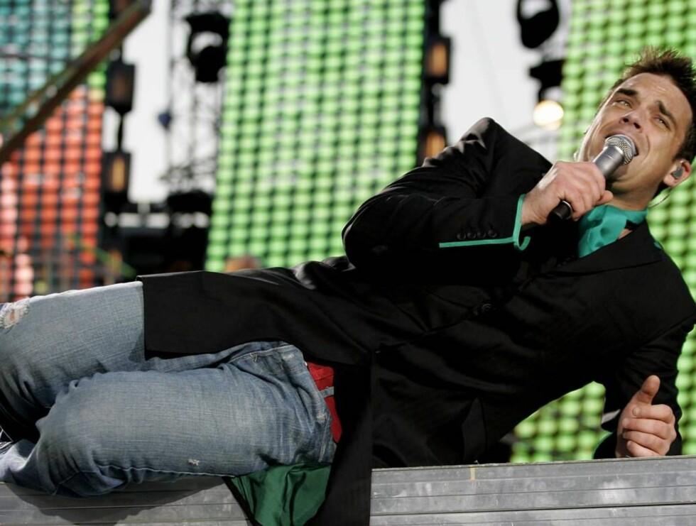 STÅR PÅ: Robbie ligger ikke på latsiden når det kommer til det andre kjønn. Foto: All Over Press
