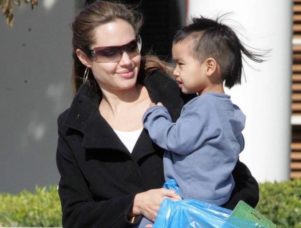 GJØR KARRIERE: Angelina er fast bestemt på å kombinere jobben med å være mamma for Maddox og søsknene. Foto: All Over Press
