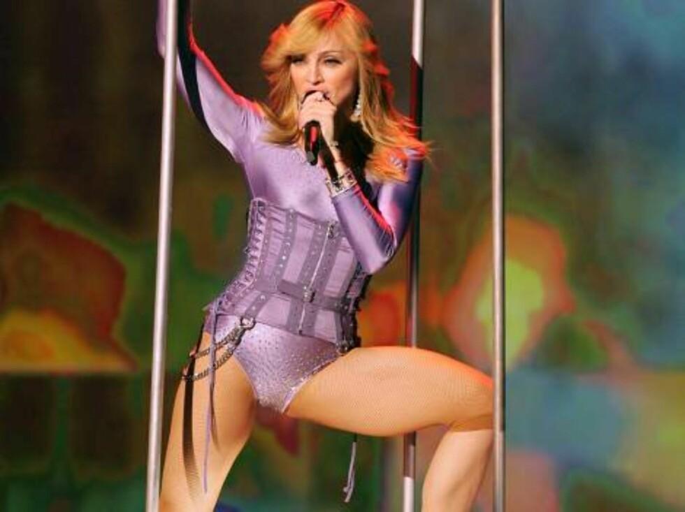 STORE LÅR?: Madonna hater lårene sine, men frontet bodytrikoten lenge. Foto: All Over Press