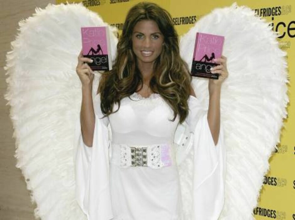 LONDON - JULY 05:  Katie Price poses with copies of her book at a book signing of her debut novel 'Angel' At Selfridges on July 5, 2006 in London.  (Photo by Gareth Cattermole/Getty Images) *** Local Caption *** Katie Price  * SPECIAL INSTRUCTIONS:  * *OB Foto: All Over Press
