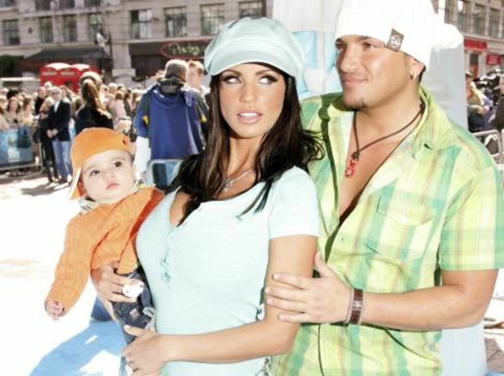 LONDON - APRIL 02:  (UK TABLOID NEWSPAPERS OUT)  Model Jordan, her husband, singer Peter Andre, and their son Junior arrive at the UK Premiere of 'Ice Age 2: The Meltdown' at the Empire Leicester Square on April 2, 2006 in London, England.  (Photo by Dave Foto: All Over Press