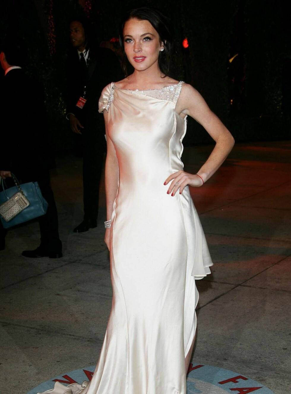 ELEGANT: Til tross for at Lindsay Lohan bare er 19 år opptrer hun allerede med stor rutine i rampelyset.  Foto: All Over Press
