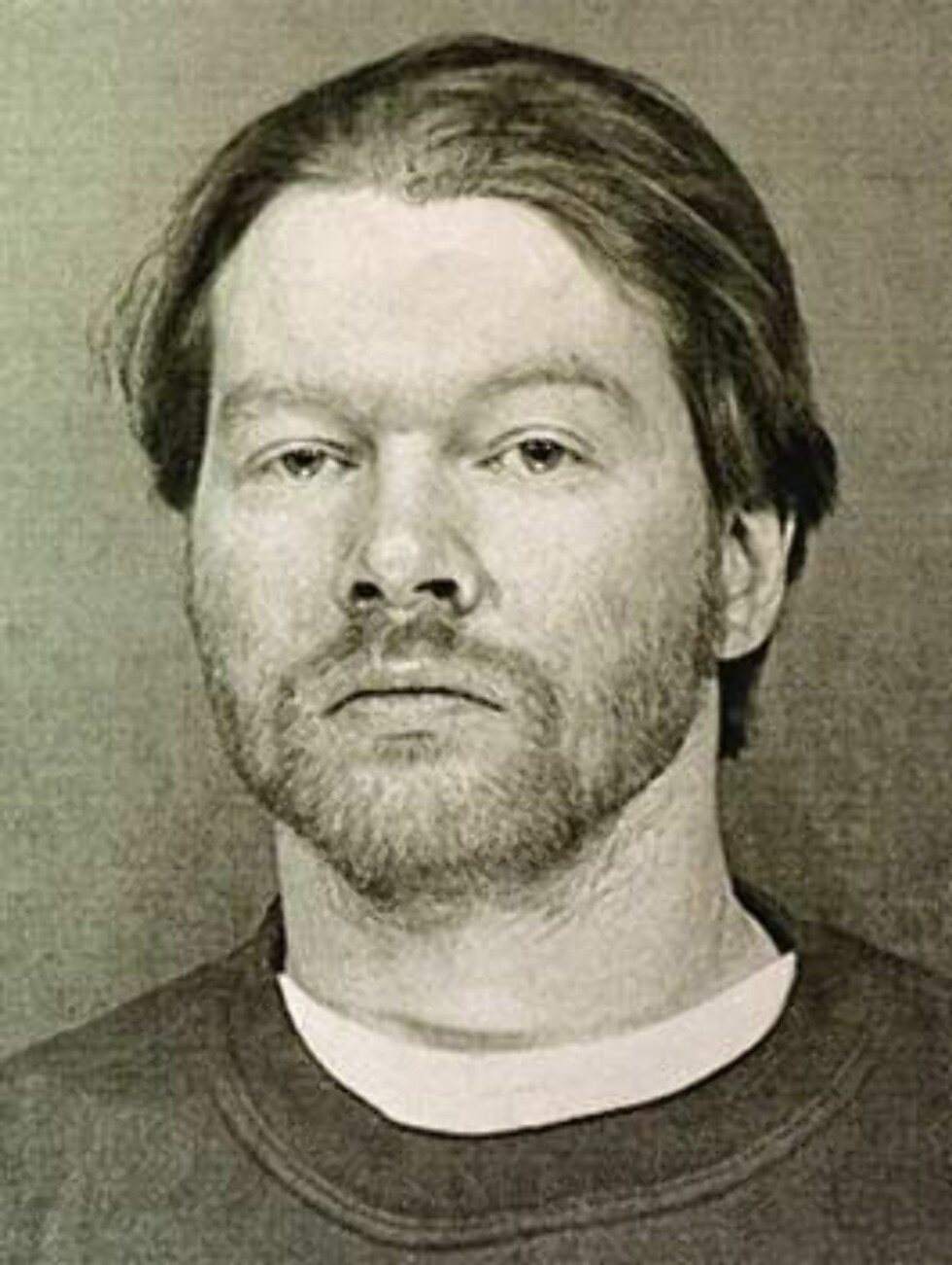 Axl Rose, lead singer for the band Guns N' Roses, shown here in a Maricopa Sheriffs booking photo after he was arrested Tuesday, Feb. 10, 1998 on a misdemeanor conduct charge for allegedly  verbally abusing a security checkpoint employee at Sky Harbor Air Foto: AP