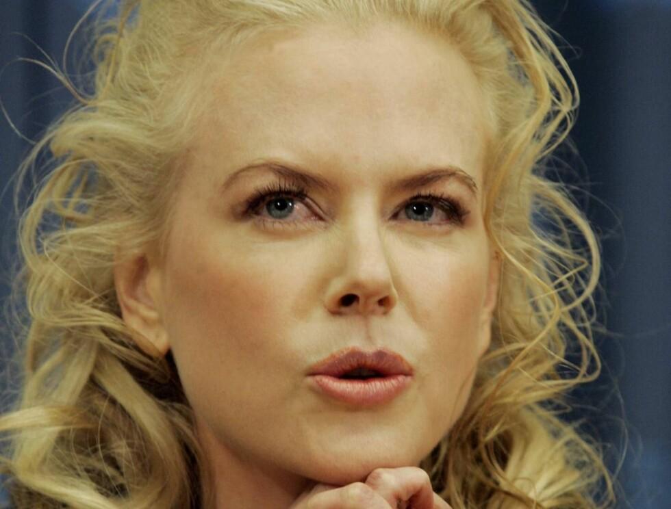 SIKRER SEG: Nicole Kidman tar ikke sjansen på at ekteskapet skal vare evig.  Foto: Scanpix/AP
