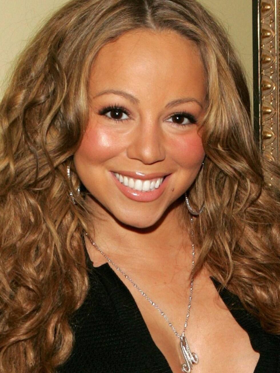RYNKEFRI: Mariah tror at hun vil holde seg rynkefri med druer. Har hun ikke hørt om rosiner... Foto: All Over Press