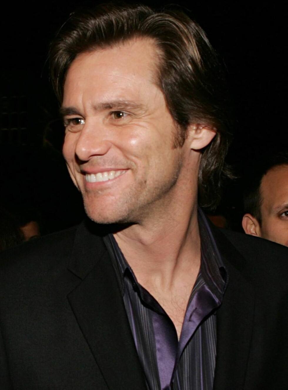 MOROMANN: Jim Carrey er ikke kjent for å holde igjen, men forholdet sitt vil han ikke snakke om. Foto: All Over Press